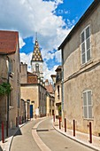 Narrow lane and the church of Saint Denis in Nuits-Saint-Georges, Burgundy, France, Europe