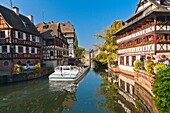 Sightseeing boat on a canal in Strasbourg, Alsace, France, Europe