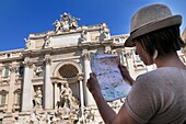 Tourist looking a map in Italy