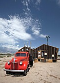 Independence, California - A vintage truck in front of a restored mess hall at the Manzanar Internment Camp, one of 10 camps where Japanese-Americans were held during World War II  The site has been preserved as the Manzanar National Historic Site by the.