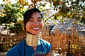 Smiling Longneck girl outdoors Approximately 300 Burmese refugees in Thailand are members of the indigenous group known as the Longnecks The largest of the three villages where the Longnecks live is called Nai Soi, located near Mae Hong Son City Longnecks