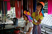 A Longneck woman helps a young girl fix her hair Approximately 300 Burmese refugees in Thailand are members of the indigenous group known as the Longnecks The largest of the three villages where the Longnecks live is called Nai Soi, located near Mae Hong