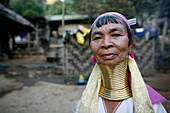 Closeup portrait of an older Longneck woman Approximately 300 Burmese refugees in Thailand are members of the indigenous group known as the Longnecks The largest of the three villages where the Longnecks live is called Nai Soi, located near Mae Hong Son C