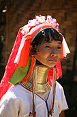 Portrait of a Longneck woman in the sun Approximately 300 Burmese refugees in Thailand are members of the indigenous group known as the Longnecks The largest of the three villages where the Longnecks live is called Nai Soi, located near Mae Hong Son City