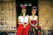 Two Longneck girls sitting outside a hut Approximately 300 Burmese refugees in Thailand are members of the indigenous group known as the Longnecks The largest of the three villages where the Longnecks live is called Nai Soi, located near Mae Hong Son City