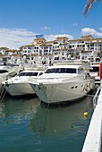Harbour PUERTO BANUS SPAIN Luxury yachts at marina jetty building overlooking harbor