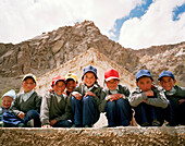 School kids in front of their school, near the convent Thagchokling in village Ney, west of Leh, Ladakh, Jammu and Kashmir, India