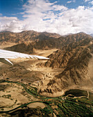 View from a jet, approach to capital city Leh via the Indus valley ahead Karakorum Range, Ladakh, Jammu and Kashmir, India