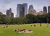 Group of girls sunbathing in Central Park, Manhattan, New York, USA