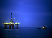 Oil drilling platform at night, Scotland