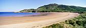 Deserted beach and Ragtin Hope Mountain, Inishowen Peninsula, County Donegal, Ireland.
