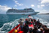Local tender boat transfer for guests of cruise ship Azamara Journey, Azamara Club Cruises, Near Tresco, Isles of Scilly, Cornwall, England
