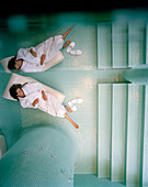Woman on a lounger in relaxation room of a spa, Langenlois, Lower Austria, Austria