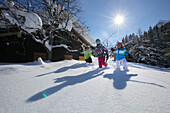 Children with skiing equipment, Vergalden, Gargellen, Montafon, Vorarlberg, Austria