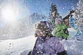 Children playing in snow, Gargellen, Montafon, Vorarlberg, Austria
