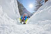 Father and child sledding, Gargellen, Montafon, Vorarlberg, Austria