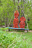 Wooden sculptures of aboriginal people, natives, in an Itelmen village, Pimtschach, Itelmens, Kamtschatka, Russia