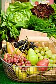 Shopping basket full of fruit, shopping at the market, Viktualienmarkt, Munich, Bavaria, Germany