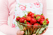Freshly picked strawberries from the garden in a glass bowl, harvest, Fruit