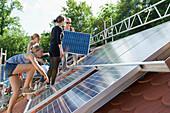 School project, students installing a solar plant, Freiburg im Breisgau, Black Forest, Baden-Wuerttemberg, Germany, Europe