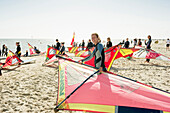 People with sails on the beach, sailboarding school, Wyk, Foehr, North Frisian Islands, Schleswig-Holstein, Germany, Europe