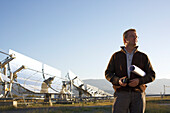 Engineer Dr. Christoph Richter (chief of DLR) in front of parabolic trough solar collectors, PSA, Plataforma Solar de Almeria, center for the research of solar energy by the DLR, German Aerospace Center, Almeria, Andalusia, Spain