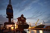 Cranes and container ship at night, Ouhua Shipyard, Zhoushan, Zhejiang province, China
