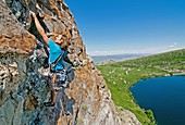 Nic Houser rock climbing a route called Angel Toes which is rated 5,10 and located on The Angel Lake Crag above Angel Lake high in the East Humboldt Mountains of northern Nevada