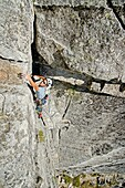 Andrew Stone rock climbing a route called Corrugation Corner which is rated 5,7 and located at Lovers Leap near Lake Tahoe in northern California