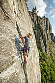 Nic Houser rock climbing a route called The Line which is rated 5,9 and located at Lovers Leap near Lake Tahoe in northern California