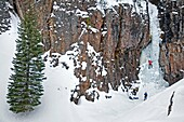 Mark Weber ice climbing a route called The Elevator Shaft which is rated WI-4 and located at the Unnamed Wall in Hyalite Canyon near the city of Bozeman in southern Montana