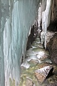Partnachklamm gorge of creek Partnach near Garmisch-Partenkirchen in Bavaria, Germany during winter  The Partnachklamm is one of the major tourist attractions of Garmisch-Partenkirchen  The gorge, which has a length of 700m and is about 80m deep, is a lis