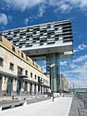 Modern Rheinauhafen property development along Rhine riverbank in Cologne Germany