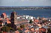 view over the historic centre of Stralsund with Saint James´s Church, Ozeaneum and Ruegen island, Hanseatic City of Stralsund, Mecklenburg-Vorpommern, Germany
