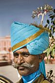 Man wearing traditional costume, City Palace, Jaipur, Rajasthan, India