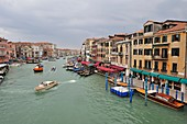 Grand Canal photographed from atop the Rialto Bridge on a cloudy day, Venice, Italy