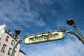 Paris, Metropolitan, building and art nouveau style subway sign