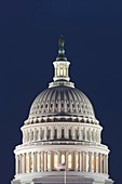 Lights illuminate the US Capitol Building after sunset in Washington DC, USA