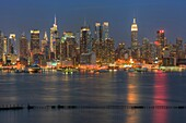 The Manhattan skyline at twilight as viewed over the Hudson River from New Jersey