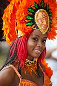 A parade participant in festive attire at the West Indian American Day Parade held on Monday, September 5, 2011 in Crown Heights, Brooklyn, New York. A parade participant in festive attire at the West Indian American Day Parade held on Monday, September 5