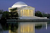 The Jefferson Memorial illuminated before sunrise on the Tidal Basin in Washington, DC, USA