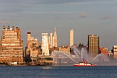 FDNY fire boat Marine 1 John D. McKean puts on a water show on the Hudson river, with the Manhattan skyline in the background, prior to the annual Macy´s Fourth of July fireworks on Saturday, July 4, 2009 in New York City, New York, USA