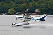 Seaplane landing on Keuka Lake at Hammondsport New York Seaplane Homecoming sponsored by the Glenn Curtis Museum