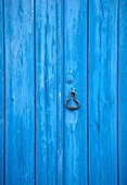 Closeup Details of a Blue Wood Rustic Wood Door of the Medieval Village of Obidos