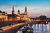 View over Elbe river to Bruehls Terrace, the academy of arts, house of the estates, Hausmannsturm tower, the Catholic Church of the Royal Court of Saxony, the Semper Opera House and Augustus bridge from left to right Dresden, Saxony, Germany, Europe