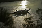 Traditional Vietnamese boat sails up Perfume River passed Vong Canh Hill near Hue central Vietnam