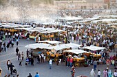 Crowds at Jemaa El Fna Square in Marrakech with food stalls and fruit sellers  Morocco