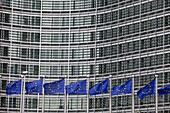 Flags wave outside the European Commission headquarters in Brussels, Belgium