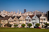 Victorian homes - the Painted Ladies with the San Francisco skyline beyond, California, USA