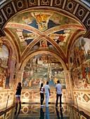 Four teenagers admiring the Pinturicchio mural in the Church of Santa Maria Maggiore.